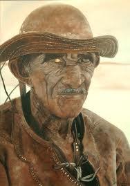 Um caboclo vaqueiro com sua paramenta, o chapéu de couro e o gibão.