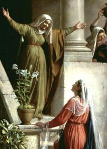 Izabel, prima de Míriam, recebe a esta na porta de sua casa.